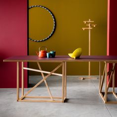 Studiomama has designed an oak trestle for furniture company Another Brand that can be rotated to make a dining table, console or a coffee table.