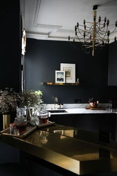 The uber-minimal kitchen #luxury #kitchen it's starting to look a lot like the PALETTE I was crushing on this 2018! love the light fixture a busier brass piece by FLOS #ad