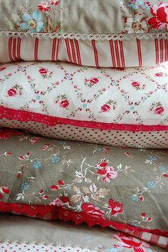 Love these red and white pillows with a bit of brown floral fabric.