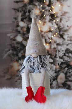 Nordic Gnome with legs This listing is for one Gnome with legs . you will get the one in the first two pictures. Style: Gnome with Legs Size: 17 from top of the head to the bottom of the socks. when sitting he is about 10 tall. Color: Gray plaid Body, Gray beard with frosted tips. Each