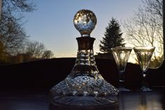 J B Chatterley Birmingham silver collar guest decanter on a Waterford base.