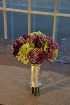 Vintage Style Bridesmaid Bouquet. This smaller version of the Vintage Style Bridal Bouquet will coordinate your bridesmaids perfectly.  Constructed with green hydrangea, lavender spray roses and purple alstromeria, interspersed with dark green ruscus.