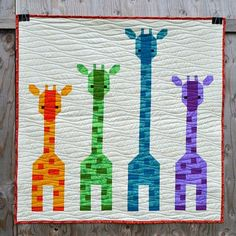 Giraffes in a Row finished size is 39 x 39 or 57 x 57. This quilt pattern comes with instructions for the 4 giraffe quilt, that finishes at 39, using one colourway (yellow/brown) or 4 different colours & for the 6 giraffe quilt, that finishes at 57, using 6 different colours. Click