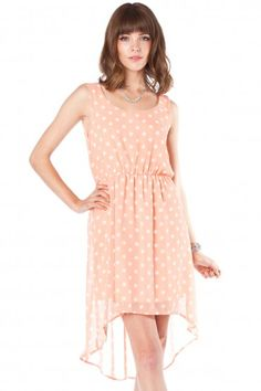 Lilah Dotted Dress - Polka dots, asymmetrical skirt, and a beautiful open back. All a girl needs.