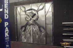 """Monster Garage Doors"" 8' X 8' functional sculpture designed and fabricated by Dan Statler #skull #art"