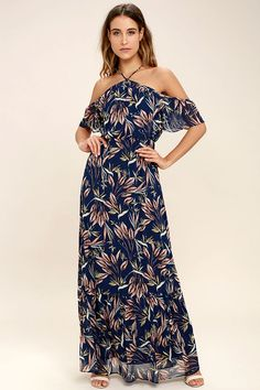 Exclusive print, only at Lulus! We hope your destination is half as dreamy as the Trip to Paradise Navy Blue Floral Print Maxi Dress! Tying straps support a halter bodice and ruffled, off-the-shoulder sleeves. Dreamy chiffon, with a blush, blue, yellow, and cream, floral print, falls from an elasticized waist into a maxi skirt with ruffled hem.