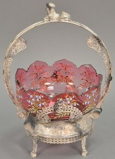 Cranberry enameled glass brides flower basket in Victorian silverplated footed basket, ht. 15 in.