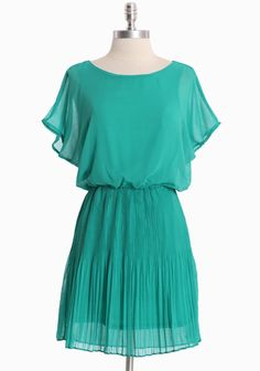 """Old Towne Adventures Pleated Dress In Green 42.99 at shopruche.com. Delicate and ethereal, this green chiffon dress is crafted with blue-green undertones, soft pleats, draped sleeves, and statement back detail. Semi-sheer and partially lined.  100% Polyester, Imported, 33"""" length from top of shoulder"""