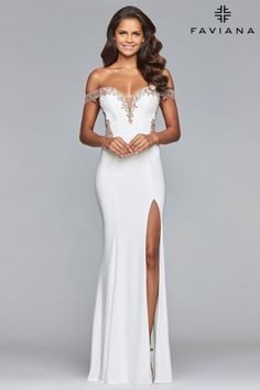 Be inspired by red carpet dresses this prom season. Faviana Style S10001, white long jersey off-the-shoulder dress with applique and sheer back bodice