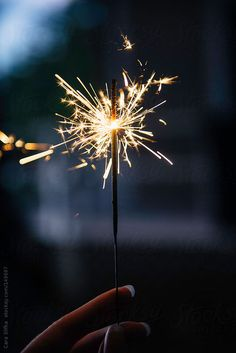 sparkler at dusk by Cara Slifka