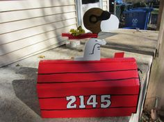Red mailbox designed like Snoopy as the Red Baron. We can make this with Woodstock or without Woodstock. Your house number or name can be painted