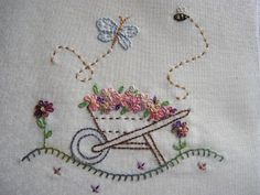 Patchwork Allsorts - wheelbarrow full of flowers with butterfly and bee