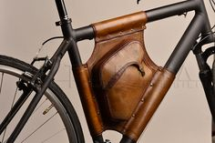 Handmande by Lithuania's StudioImpossibilis, this leather bicycle bag fits into the V-shaped opening in the center of most bicycles. It's leakproof and durable, and weathering just makes it look better. Contact seller for size specs.