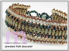 Jeweled Path Bracelet   Designed by Mabeline Gidez.   SuperDuos form a path down the center with crystal channels along the sides of this RAW bracelet.