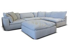 If you are looking for a sectional to lose yourself in, then look no further. Just make sure to supervise small pets and children. The Taryn is a modular sectional that is regularly stocked in Fresh Dove or Fresh Smoke Fabric. Pieces are sold separately so that you can configure it to fit your space.