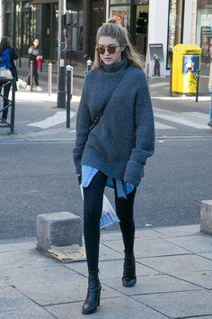 Gigi ran errands around Paris in leggings, booties, an oversize chambray shirt, and a luxe turtleneck sweat...