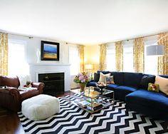 Ahhh... Herringbone rug, navy & gold, but my favorite piece is the table. Love. Love. Love.