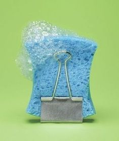 use a binder clip as a sponge stand 33 meticulous cleaning tricks for the