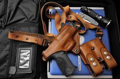 EDC  This is what I'm looking for for my .45. Brown leather shoulder holster. Nice