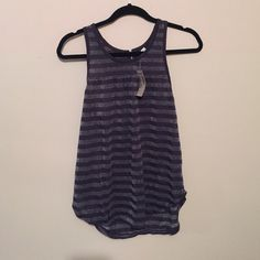 NWT Striped sparkly gray tank top Dark gray and sparkly gray striped flowy stretchy tank top. Short zipper in the back. Size small but could probably fit a medium too. Never worn. American Eagle Outfitters Tops Tank Tops