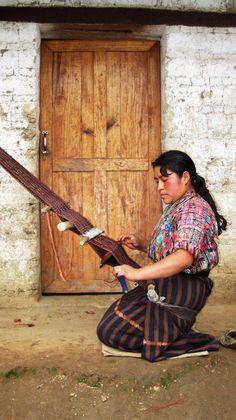 nepal woman weaving on a backstrap loom