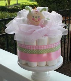 simple diaper cake with a toy in the middle