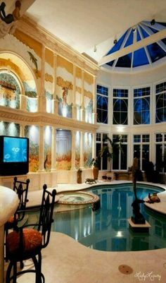 Home Design and Decor , Decorating Your Indoor Swimming Pool : Indoor Swimming Pool With Dolphin Statue And Houseplants And Wall Murals Future House, Piscina Interior, Indoor Swimming Pools, Pools Inground, Kids Swimming, Luxury Pools, Dream Pools, Beautiful Pools, Cool Pools