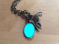 This listing is for a adorable, Antique bronze Glow in the dark Butterfly necklace. The glowing part of the necklace is made out of Resin and can either be made with green or blue glow in the dark eff