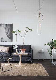 Greys, pinks, rustic earthen works, metals, simple, living room