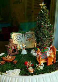 Miniature Fairy Garden - THE TWISTED 'TWAS THE NIGHT BEFORE CHRISTMAS has its own twist from the original story: early Christmas morning, Santa Claus along with the three mice are seen sleeping meanwhile a Christmas fairy delivers their gifts. Santa and the three sleeping mice made chocolate chip cookies for the fairy. The fairy left candy canes in the Christmas stockings, however, hungry mice are seen chomping on them! The three mice did a good job decorating the Christmas tree. 11/2016