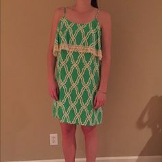 Fabrik Dress Lightweight spring green with two layers and adorable fringe. Great for summertime! Pair with sandals for a day time date, or heels for a fun night out. Fabrik Dresses