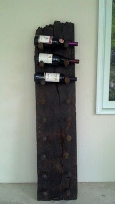 Barn wood with antique railroad nails wine rack...$300 contact aedeveau@gmail.com...we also do custom designs!