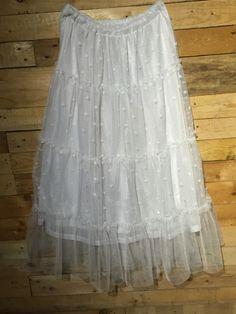 Falda plumero