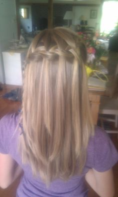 Waterfall braid...I just helped a neighbor do this to her hair for prom and it is so pretty!