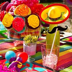 Put together a Cinco-style table setting for each guest with Mexican sodas topped with mini sombreros and mustaches!