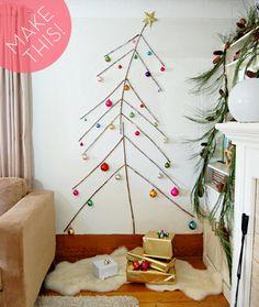 Space-saving #DIY twig Christmas tree - I wish we had this much wall to devote.