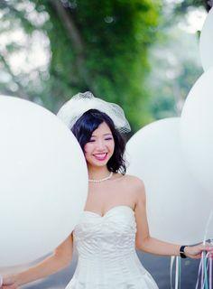 Bride with balloons. A Charming Wedding at MASONS: Lu and Kat