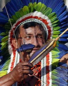 A member of the Kuikuro Brazilian indigenous group aims his arrow during the bow-and-arrow competition at the XII Games of the Indigenous People in Cuiaba. Forty eight Brazilian Indigenous tribes will present their cultural rituals and compete in traditional sports such as archery, running with logs and canoeing during the XII Games of Indigenous People which will run until November 16. Picture: REUTERS/Paulo Whitaker