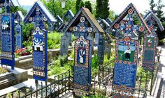 Merry Cemetery, Sapanta, Romania: This cemetery is a unique place because of its very brightly colored gravestones. These wooden headstones commemorate the deceased with a funny saying or by depicting a scene from the occupants' lives. World's Most Beautiful, Most Beautiful Pictures, Beautiful Places, Visit Romania, Carpathian Mountains, Travel 2017, World Religions, Destinations, Architecture Old