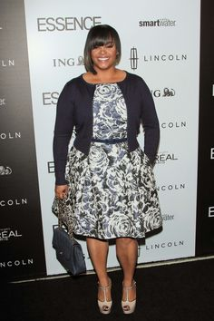 jill scott singer. Great clothing role model. Nice floral patterned dress.