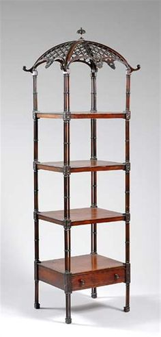 George III Mahogany Whatnot Late 18th century The domed pierced trellis pagoda-form top with leafage scrolling edge, above three shelves and a drawer having triple columnar supports with rosette carved decoration, raised on similar legs.