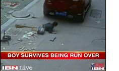 Chinese Boy Survives After Car Runs Over Him