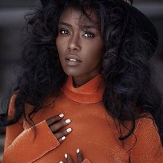 Ethiopian Model Tahuonia Rubel. Raw Beauty. Her skin and complexion! Also absolutely loving the extra-white nails on her black skin and her orange  sweater.