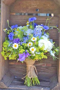 Pretty wild flower look wedding bouquet...Farm/Garden Wedding