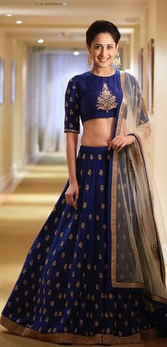 Blue and golden lehenga choli set. The lehenga choli is a custom made garment which include the blouse, lehenga(skirt) and the dupatta (stole). Skirt and blouse are in silk and stole material is net. It can be customised in any color of your choice. Blouse length can be made