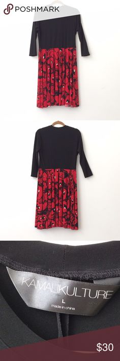"""Kamalikulture Dress Size L Beautiful black/print dress (black, white, red colors on bottom) size large by Kamalikulture. Very flowy, pretty bottom.  Possibly it's polyester/spandex.   In great condition. Accent it w/a great belt or long necklace!   Approximate measurements:  Bust = 38"""" Length = 37"""" Sleeve = 17""""   Can share more photos.   Open to offers.   Thank you! Kamalikulture Dresses"""