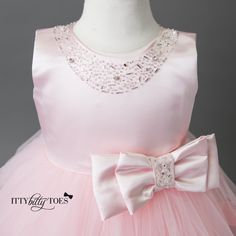 This gorgeous pink dress is a piece from our exclusive Gjergjani couture line. It's the perfect pink dress for any glamorous little girl! The bodice of the dre