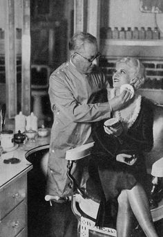 Jean Harlow getting her make-up done by Max Factor, 1930.