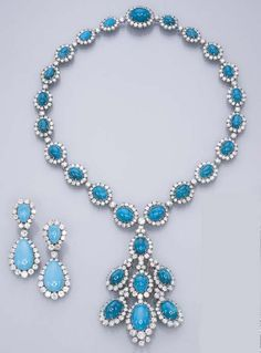 A SET OF TURQUOISE AND DIAMOND JEWELLERY  Comprising a pendent necklace, the detachable pendant designed as a series of graduated cabochon turquoise, each in a circular-cut diamond surround, with diamond spacers suspended from a necklace of similar design; and a pair of detachable ear pendants en suite (necklace with concealed pendent hoop, pendant may be worn as a clip brooch)