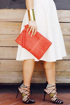 We're loving this bold, bright purse and these fun heels! How to Elevate Your Weekend Basics #theeverygirl